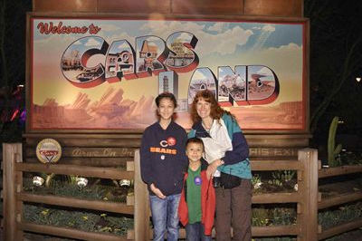 Jeri, Lizzie, and Josiah just outside of Cars Land