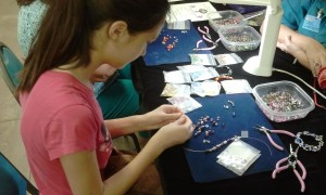 Lizzie Adding Pieces to Her Necklace. Click photo for full size.