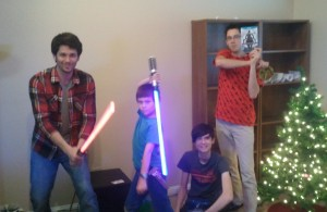The boys along with two light sabers. Click photo for full size.