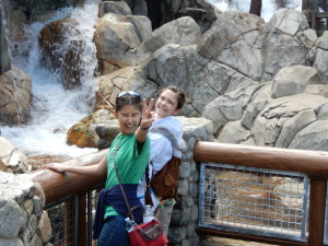 Jessica and Lizzie watching riders get wet at Grizzly River Run. Click photo for full size.