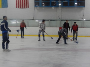 Tim, Jason, and Justin Playing Broomball. Click photo for full size.