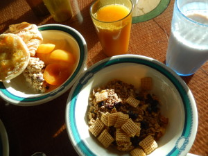 Breakfast - English muffin, croissant, muesli, peaches, cereal, orange juice, and soy milk. Click photo for full size.