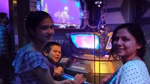 Lizzie, Josiah, and Victoria nearing the end of the line for Star Tours. Click photo for full size.