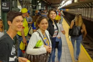 Jeffrey, Victoria, and Joanna waiting for the subway train. Click photo for full size.