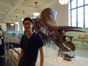 Jeffrey next to a triceratops in the American Museum of Natural History. Click photo for full size.