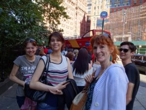 Nicole, Joanna, Jeri, and Jeffrey waiting (forever) for the next tour bus to pick us up. Click photo for full size.