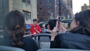 Tour bus guide with red shirt. Click photo for full size.