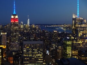Nighttime view of Downtown Manhattan from the Top of the Rock with the Empire State Building lit in red, white, and blue. Click photo for full size.