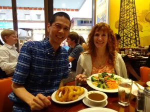 Tim and Jeri at Junior's sharing onion rings and a nice salad. Click photo for full size.