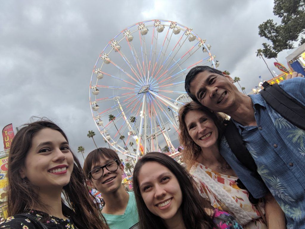 Joanna, Josiah, Victoria, Jeri, and Tim with the Ferris wheel behind
