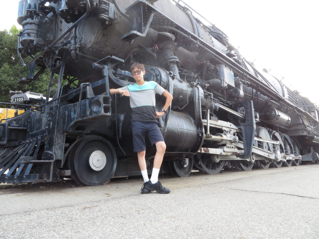 Josiah next to a steam engine
