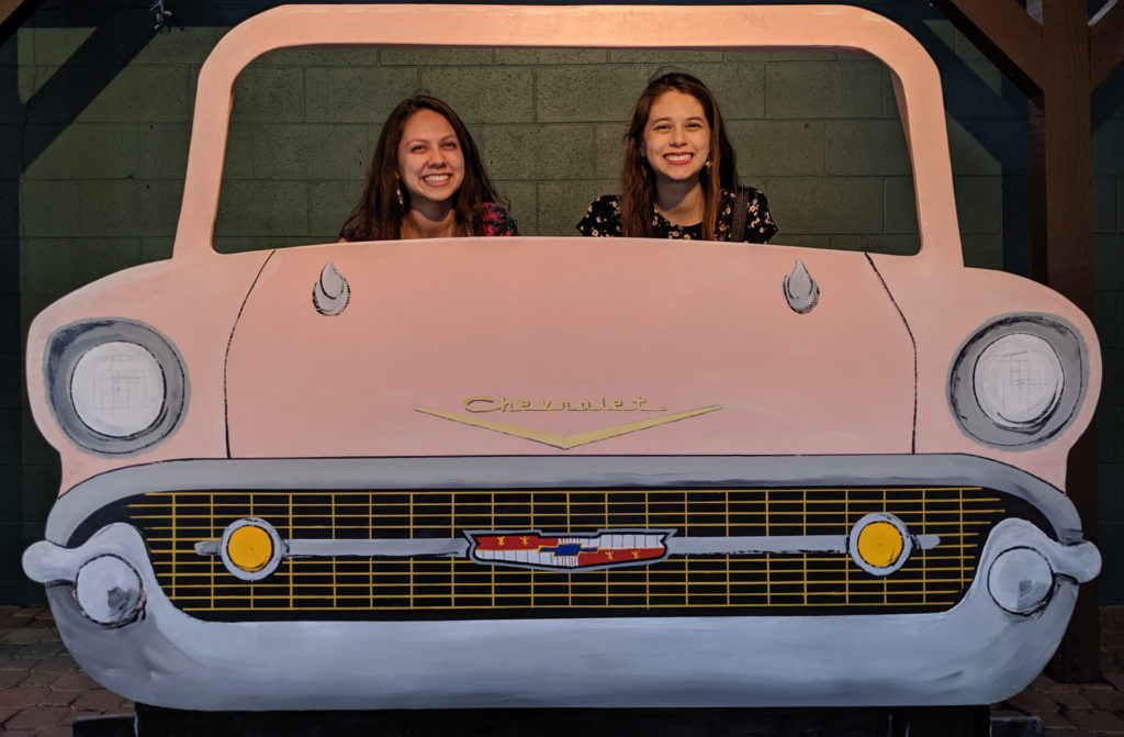 Victoria and Joanna driving an old Chevy